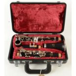 A Yahama clarinet, in a fitted maroon fabric lined case.