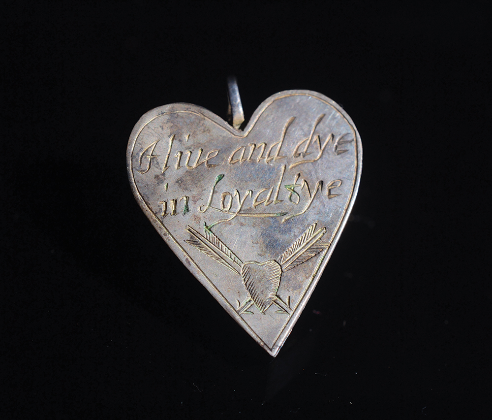 A Royalist heart shaped silver locket,