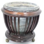 A 19th century jardiniere, with earthenware liner,