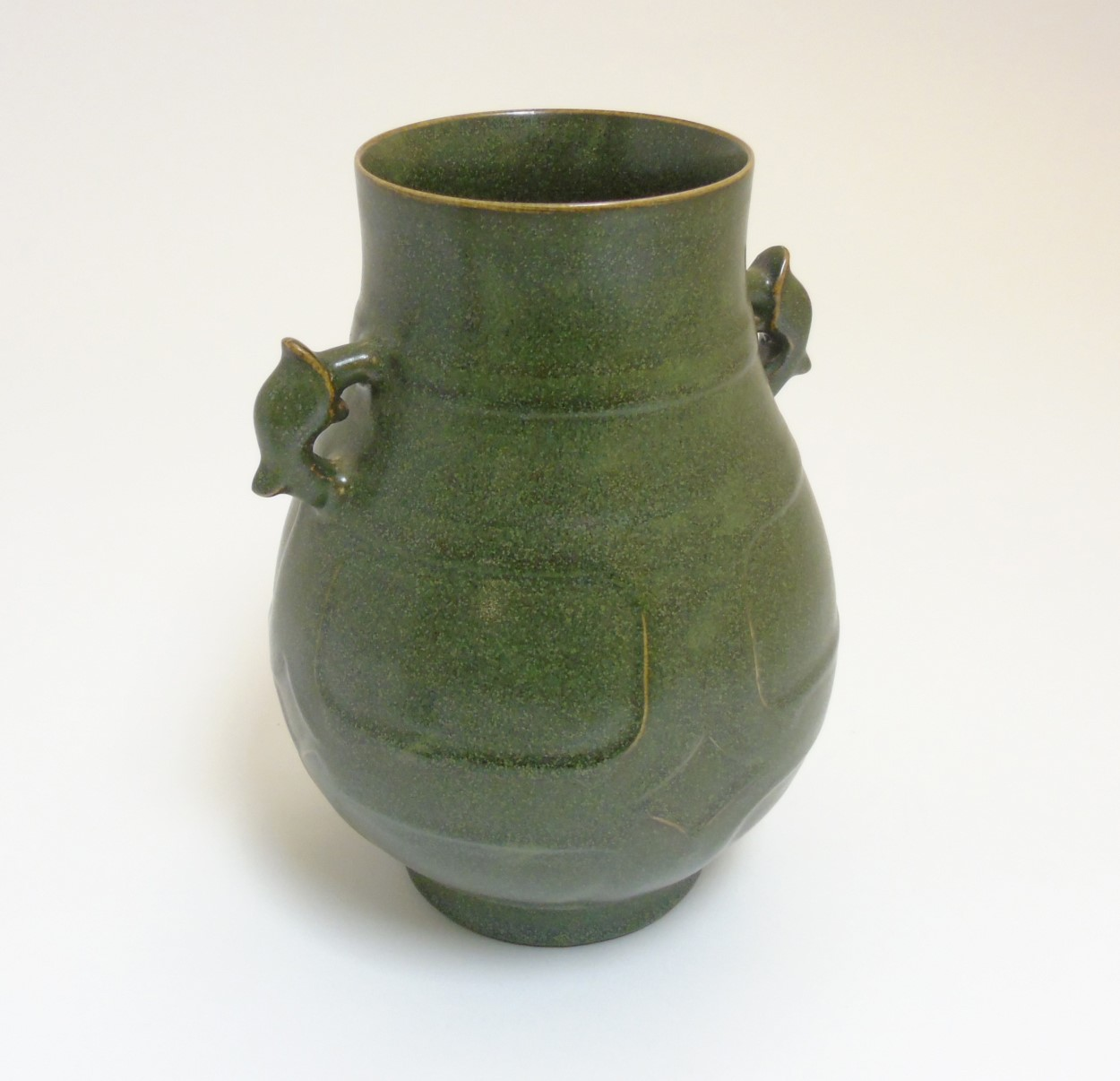 Lot 33 - A Chinese tea dust glazed Hu vase, having handles in the form of the tianlu animal,
