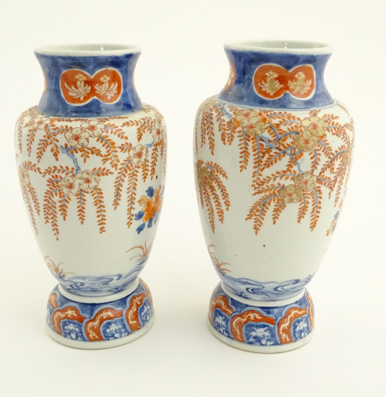 "Lot 24 - Two Imari vases depicting a garden landscape. Approx. 12"" high."