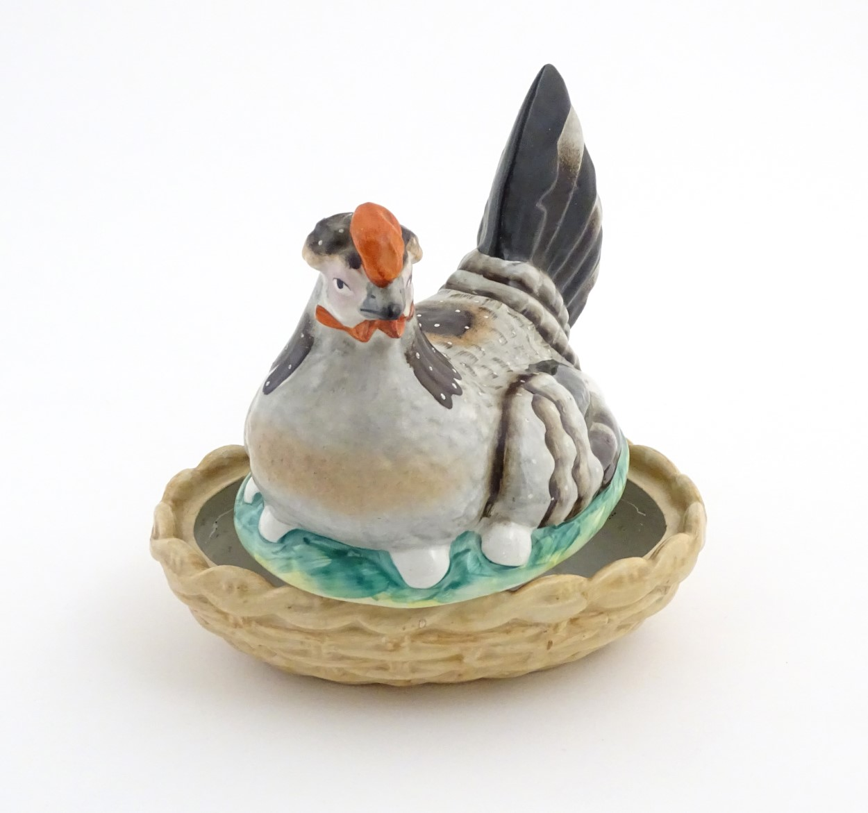 Lot 53 - A 19thC Staffordshire hen on nest tureen with light brown basket, approx.