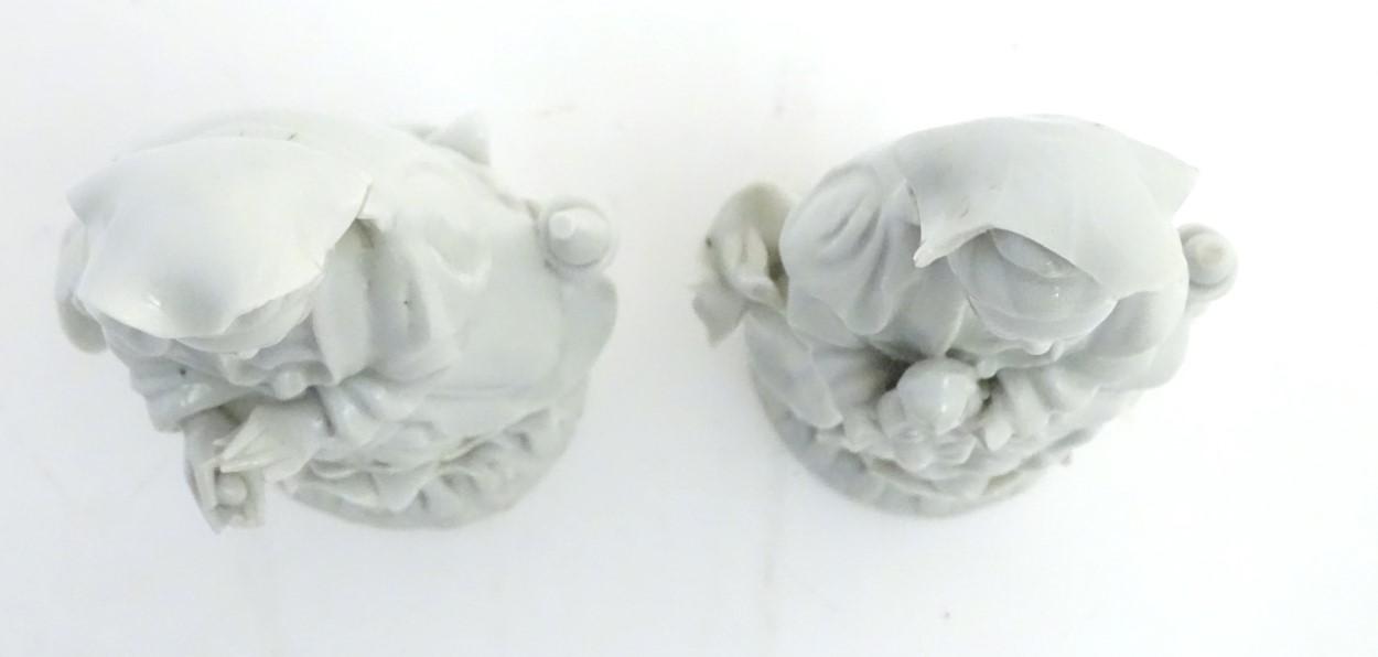 Lot 9 - A matched pair of dehua porcelain/blanc de Chine figures,