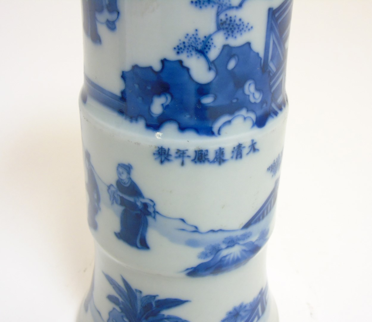 Lot 32 - A Chinese blue and white Gu vase with underglaze blue decoration depicting imperials in a pagoda