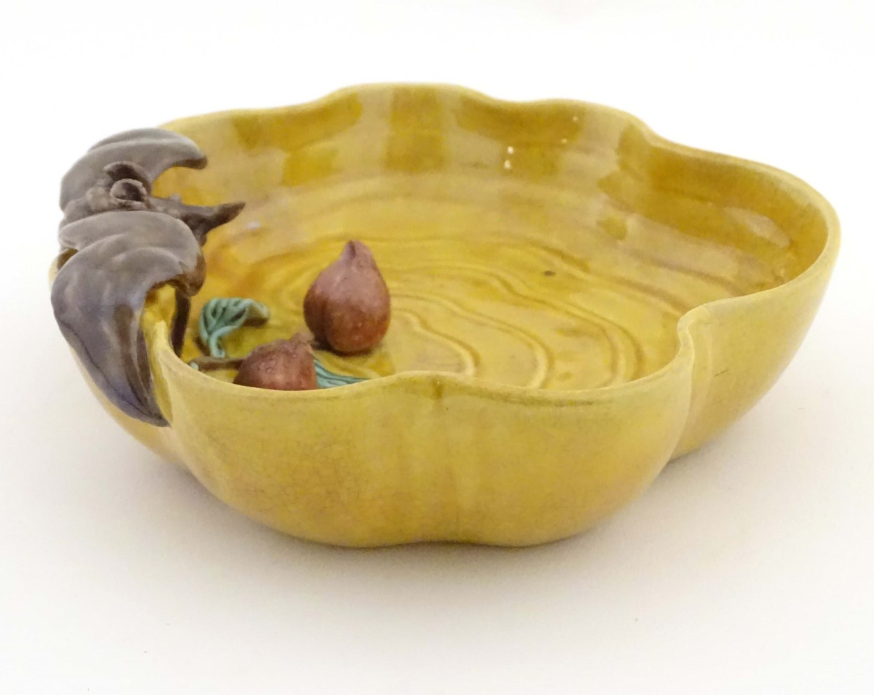 Lot 35 - A Chinese wavy edged yellow brush wash dish with bat and fruit decoration,