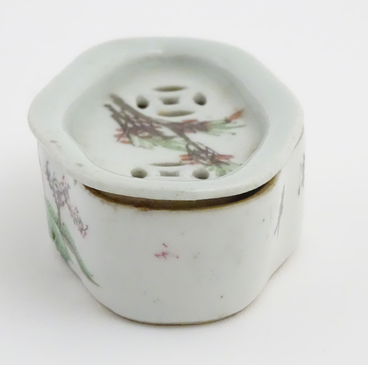 Lot 42 - A Chinese lozenge lidded dish hand painted with 4 character markings and a figure in a landscape to