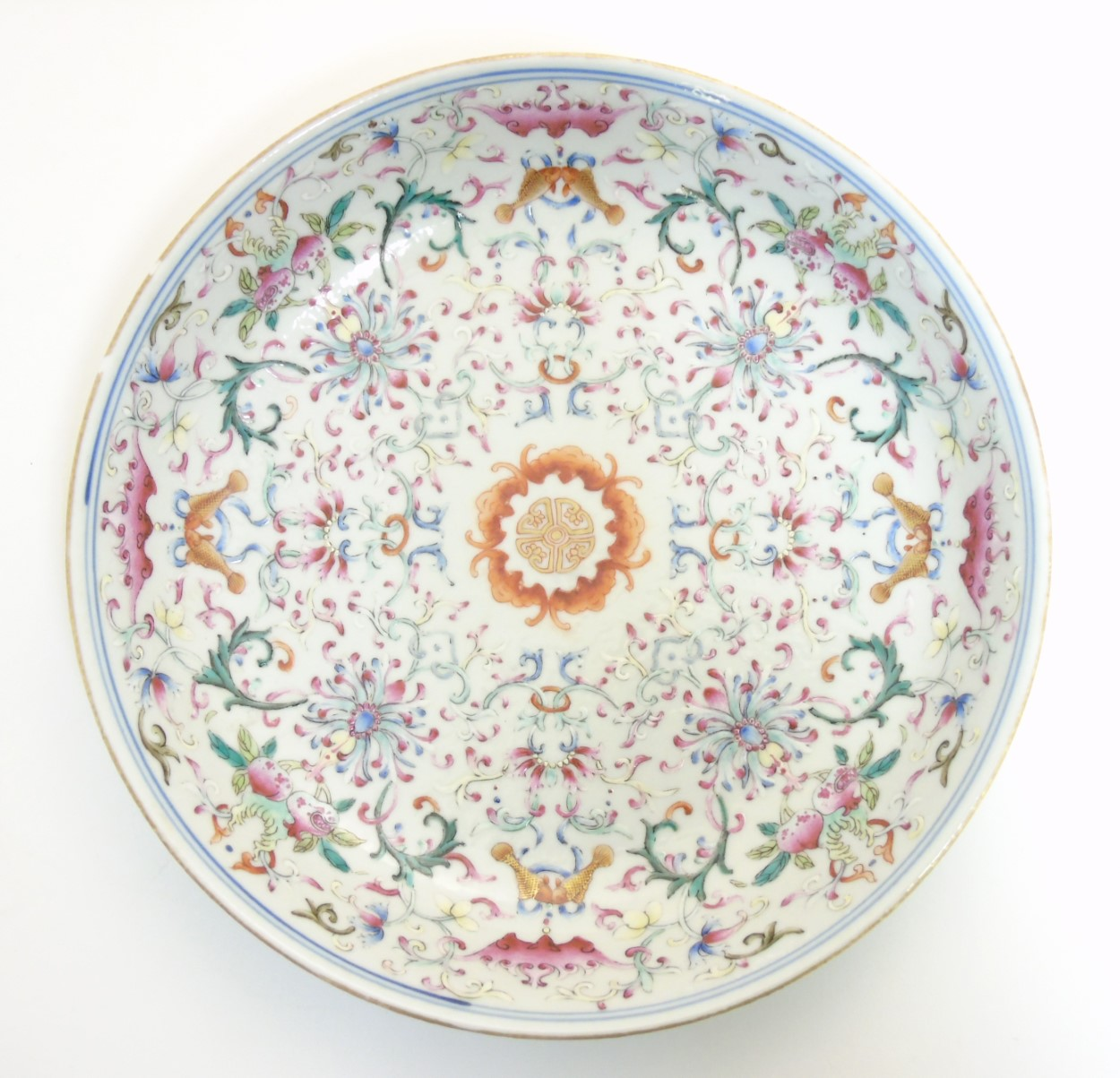 Lot 12 - A Chinese famille rose plate, decorated with scrolling lotus flowers, having bat,