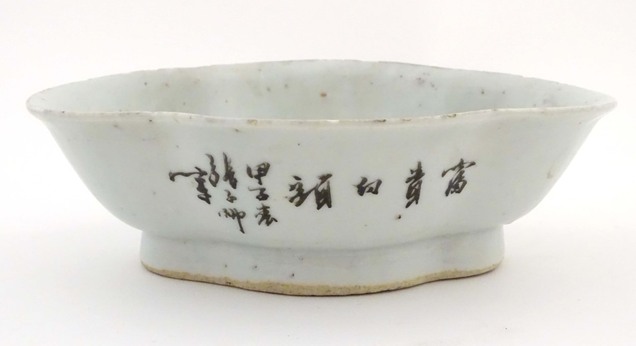 Lot 39 - An oriental quatrefoil/lozenge shaped dish with hand painted decoration to include Chinese
