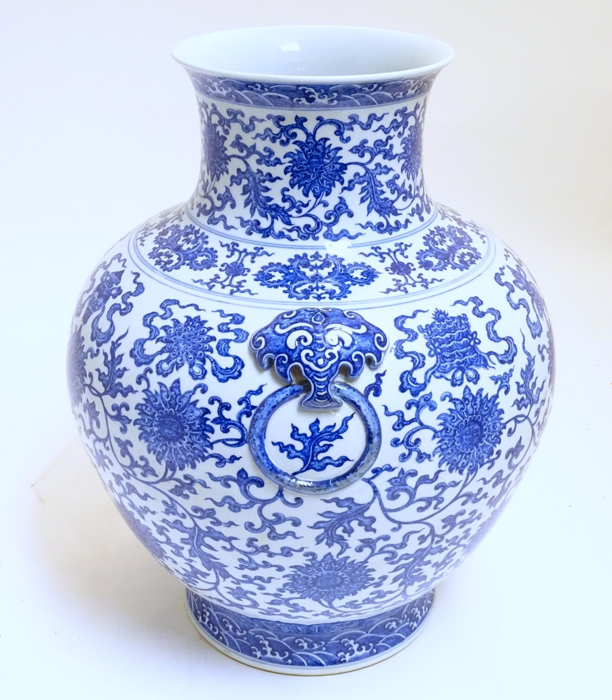 Lot 14 - A large Chinese blue and white vase, depicting scrolling lotus with shou character to centre flower,