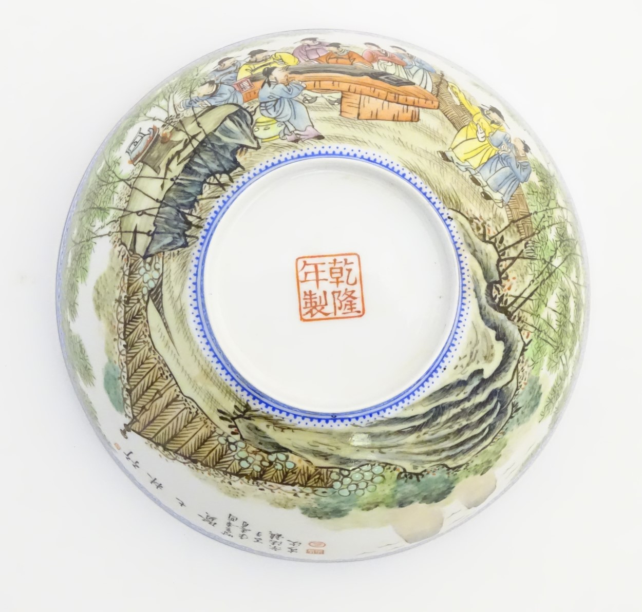 Lot 10 - A Chinese eggshell bowl depicting oriental figures watching a guqin performance in a landscape.