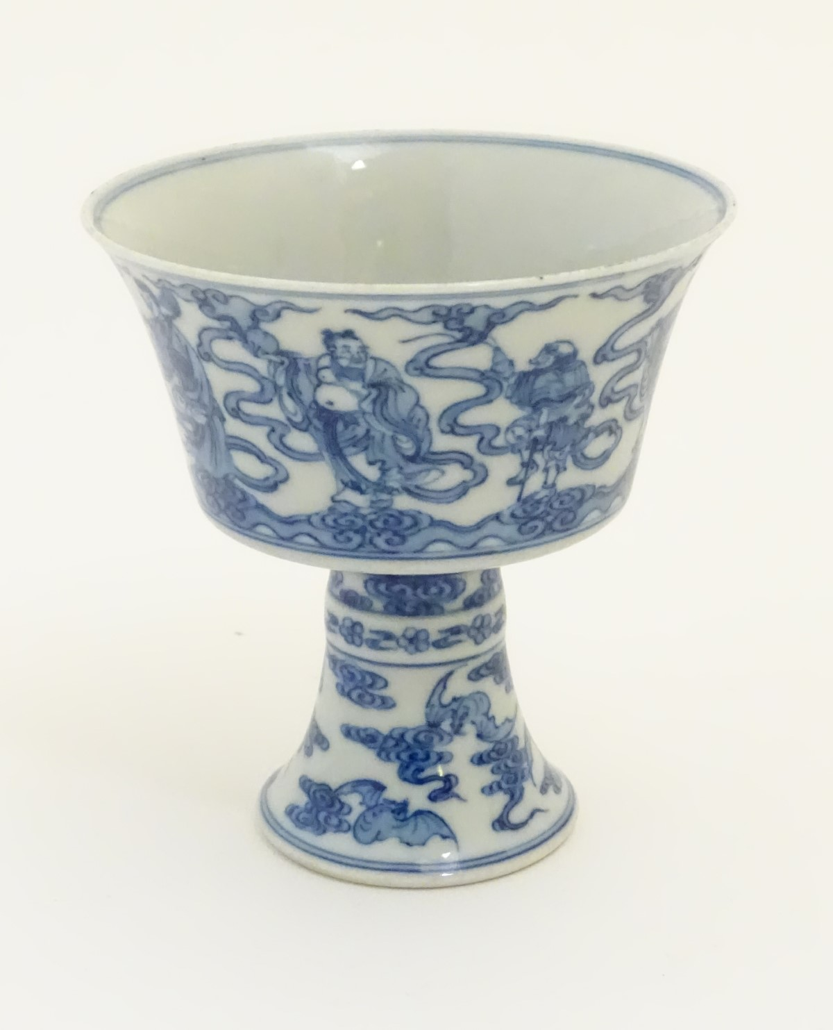 Lot 1 - A Chinese blue and white stem cup / high footed cup decorated with stylised clouds,