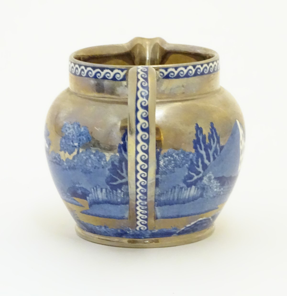 Lot 39 - A Wedgwood of Etruria & Barlaston blue and white lustre cream jug in the pattern 'Fallow Deer',
