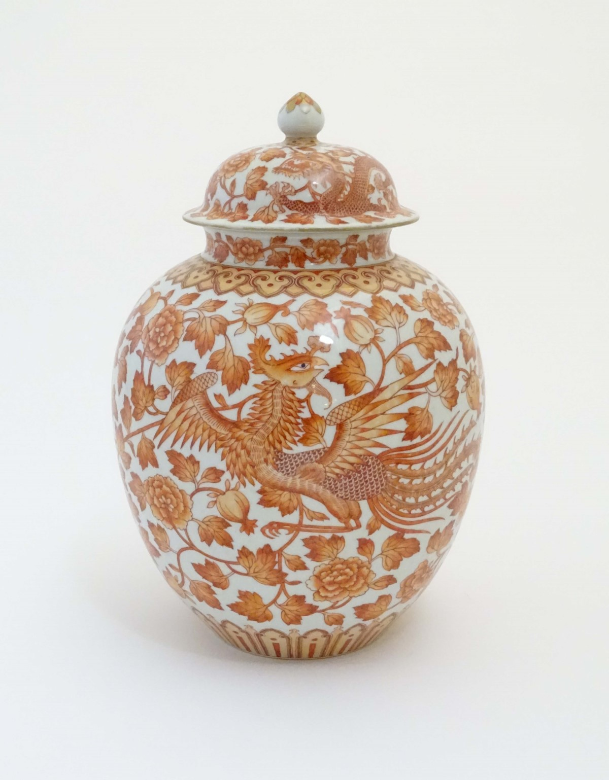 Lot 32 - A Chinese orange and white lidded ginger jar decorated with dragons,