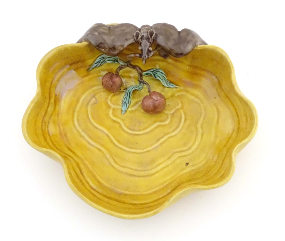 Lot 6 - A Chinese wavy edged yellow brush wash dish with bat and fruit decoration,