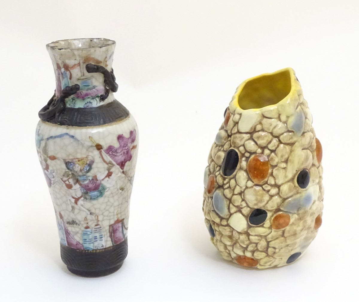 """Lot 49 - An asymmetrical Sylvac vase with pebble decoration. Impressed marks to base. Approx. 6 1/2"""" high."""