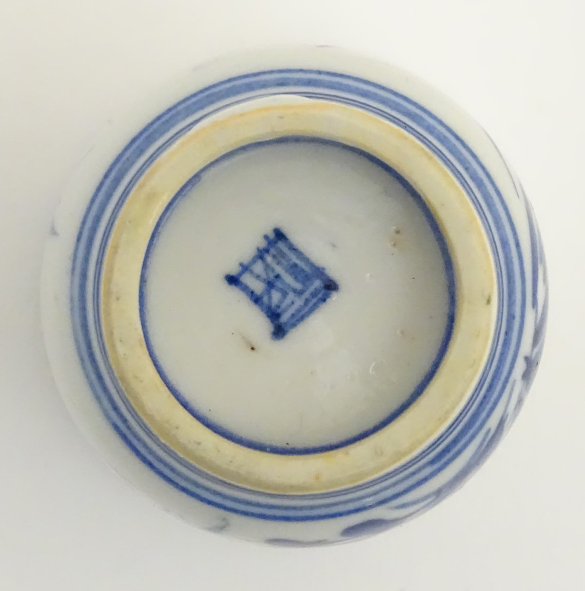 Lot 25 - A Japanese blue and white pot with hand painted floral and foliate decoration.