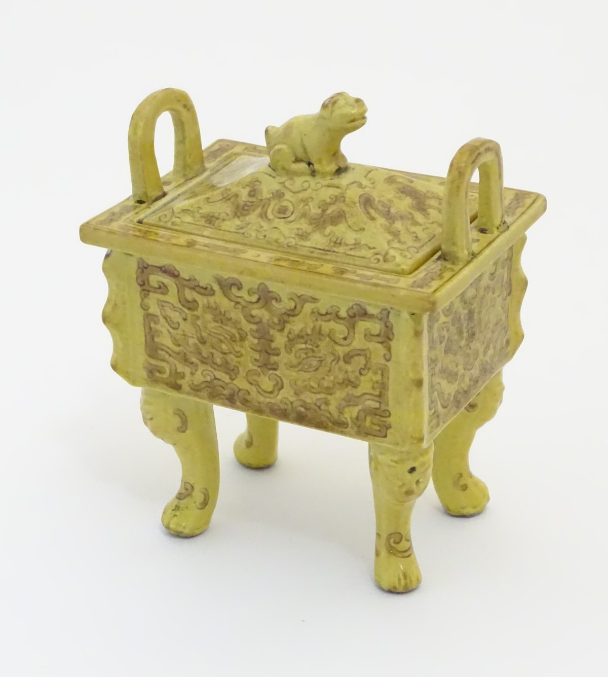 Lot 26 - A Chinese rectangular censer with a yellow ground, raised on 4 paw footed legs,