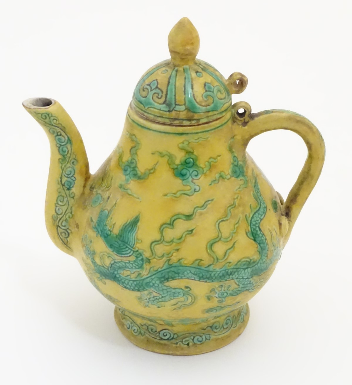 Lot 4 - A Chinese yellow ground small proportion lidded wine ewer decorated with green stylised dragons and