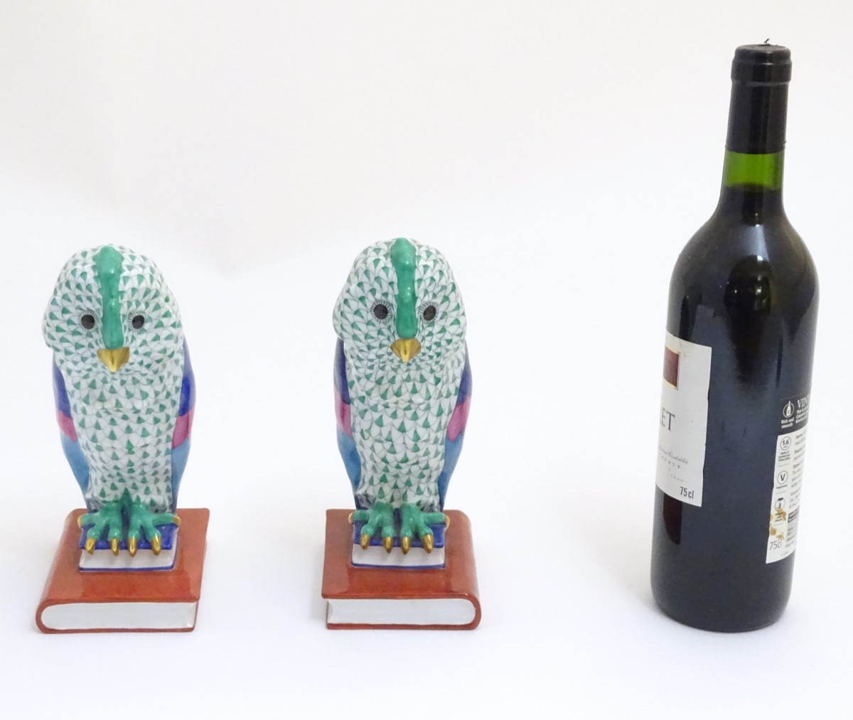 Lot 50 - A pair of hand painted Herend pottery bookends,