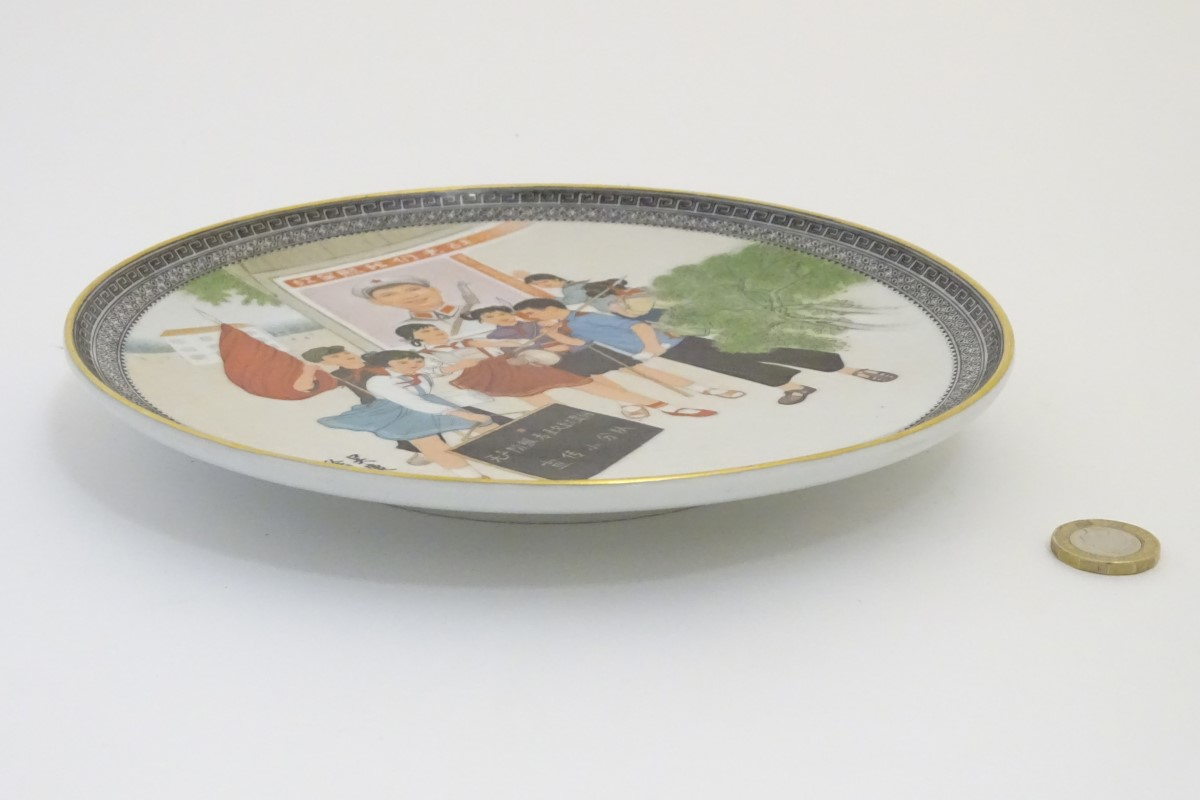 Lot 30 - A Chinese propaganda plate depicting protesting children. Character marks under. Approx.