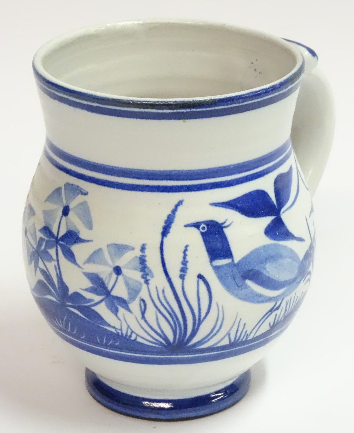Lot 55 - A Laurence McGowan British studio pottery vase with a single handle,
