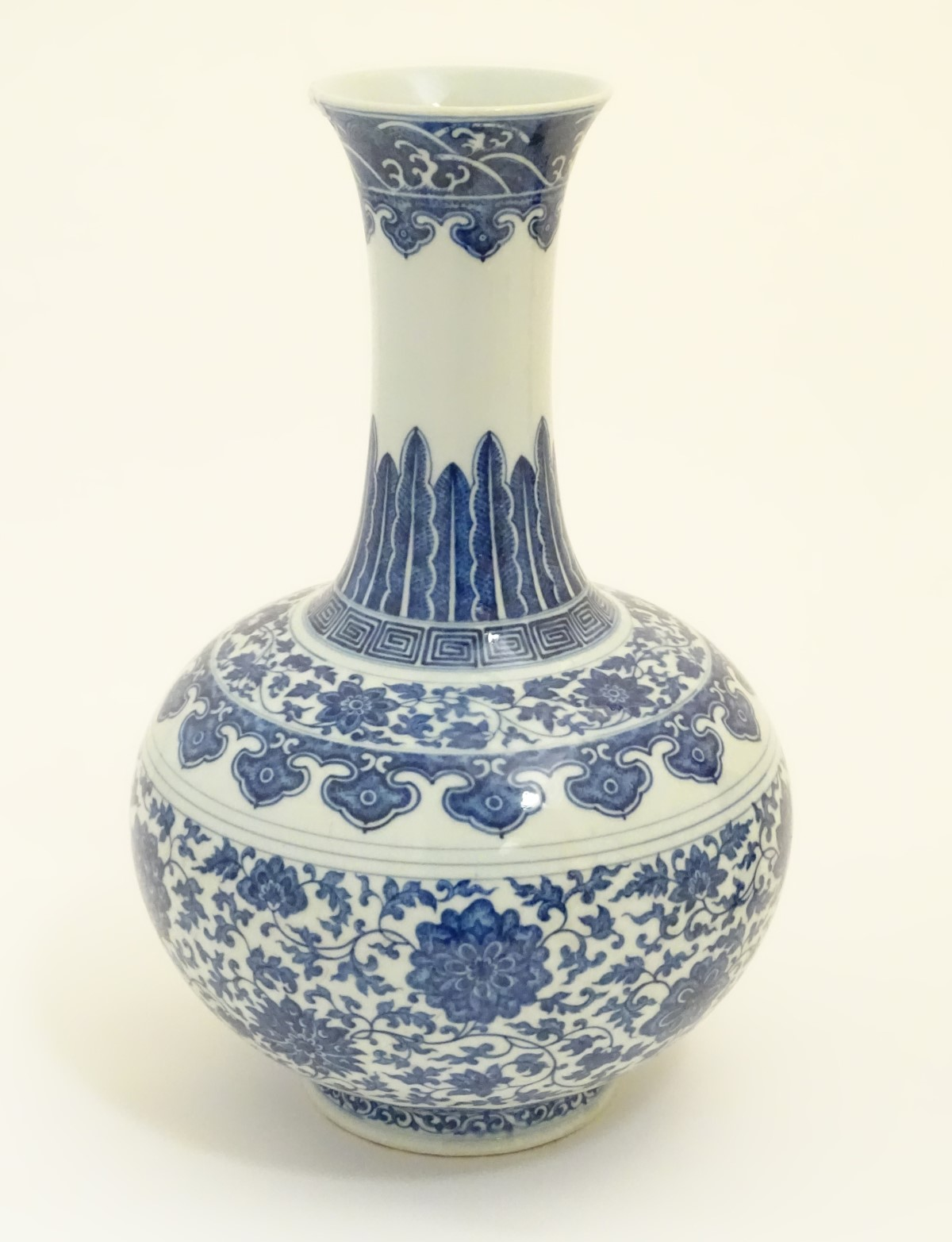 Lot 14 - A Chinese blue and white 'Shang Ping' vase decorated with a broad band of flowers and scrolling