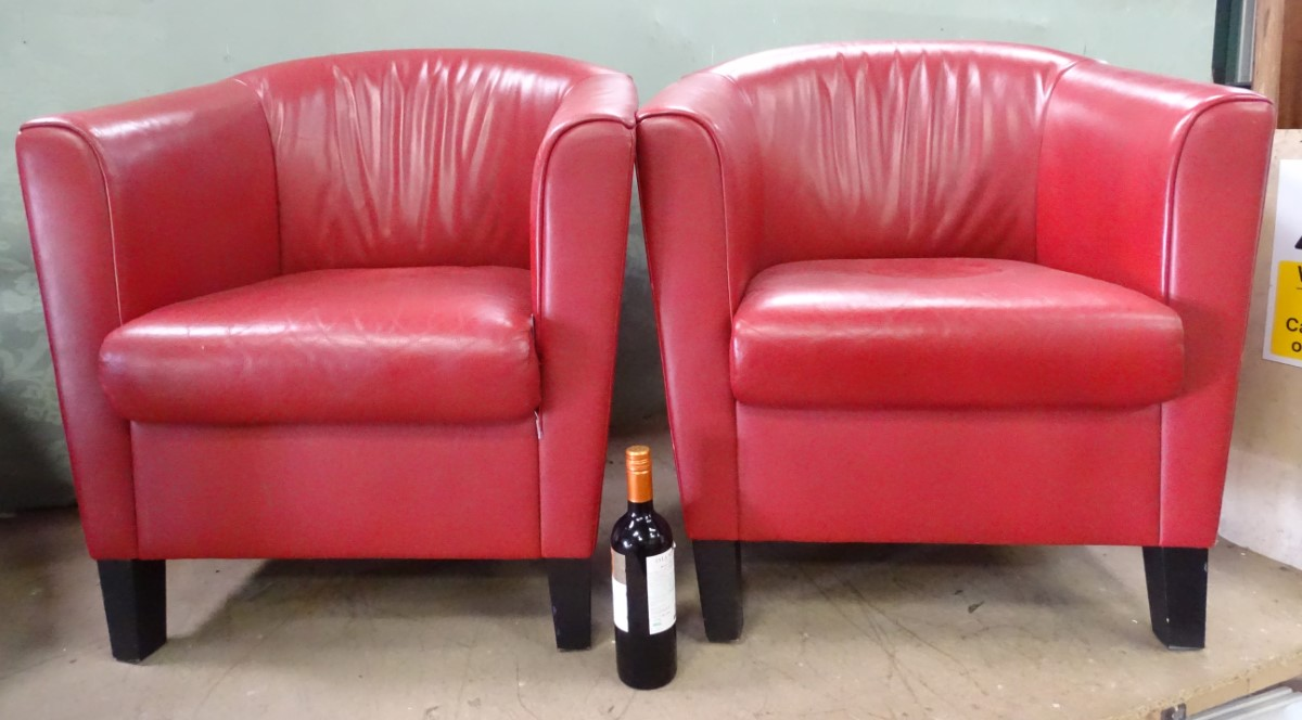Lot 23 - A pair of red leather tub chairs by Wittmann,