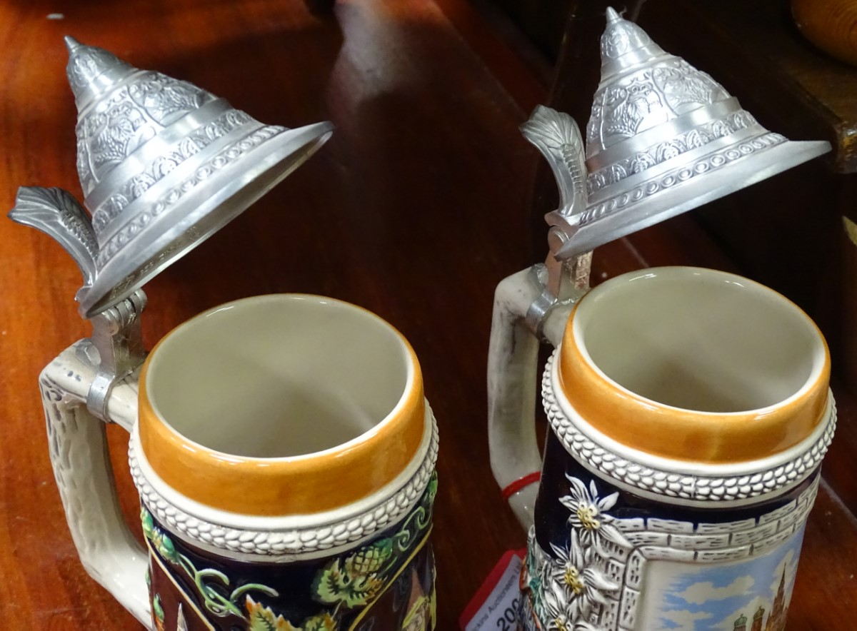 Lot 11 - A pair of German ceramic Stein mugs, with Munich decoration.