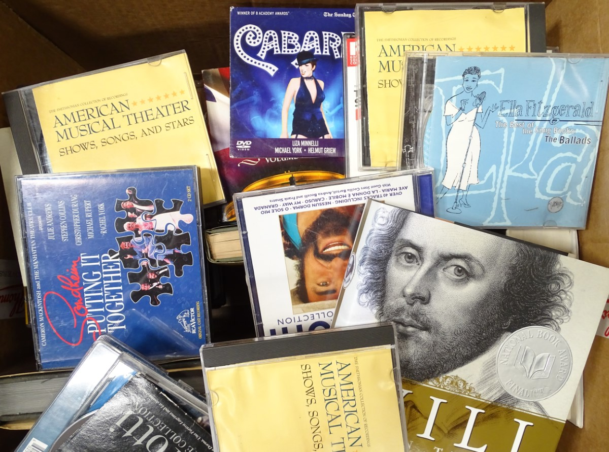 Lot 48 - A box of hardback books and CDs, to include The Noel Coward Diaries, Amy Winehouse CDs etc.