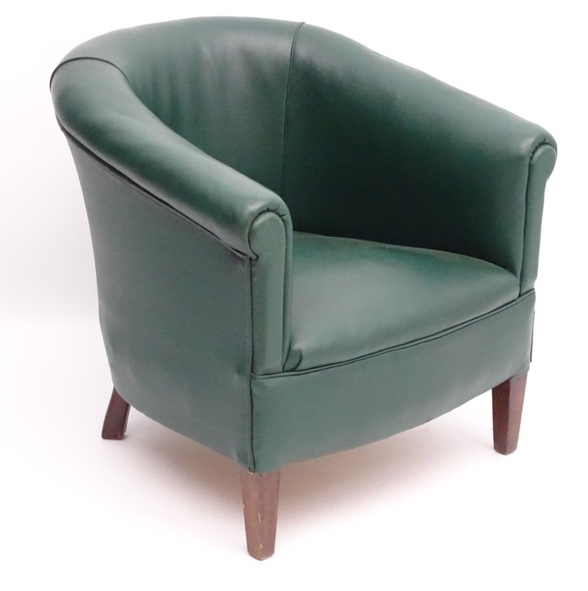 """Lot 57 - A mid 20thC green tub chair standing on squared tapering legs. 28"""" wide x 25"""" deep."""