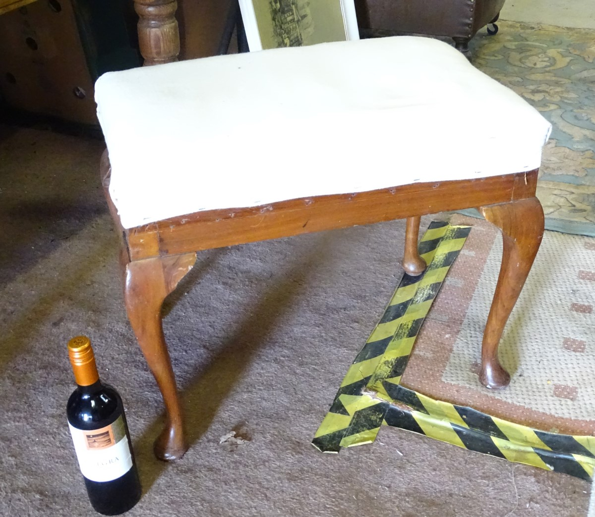 Lot 22 - A walnut occasional stool with cabriole legs CONDITION: Please Note - we do not