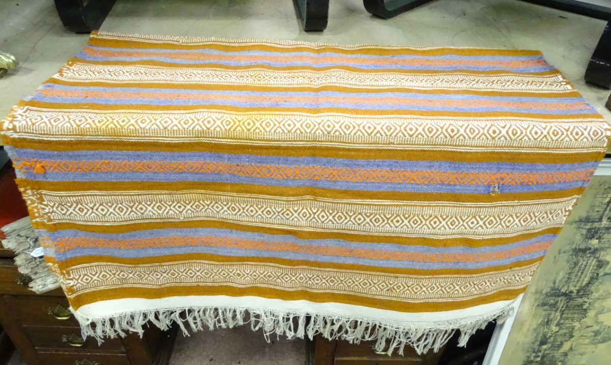 Lot 16 - A rug with orange,