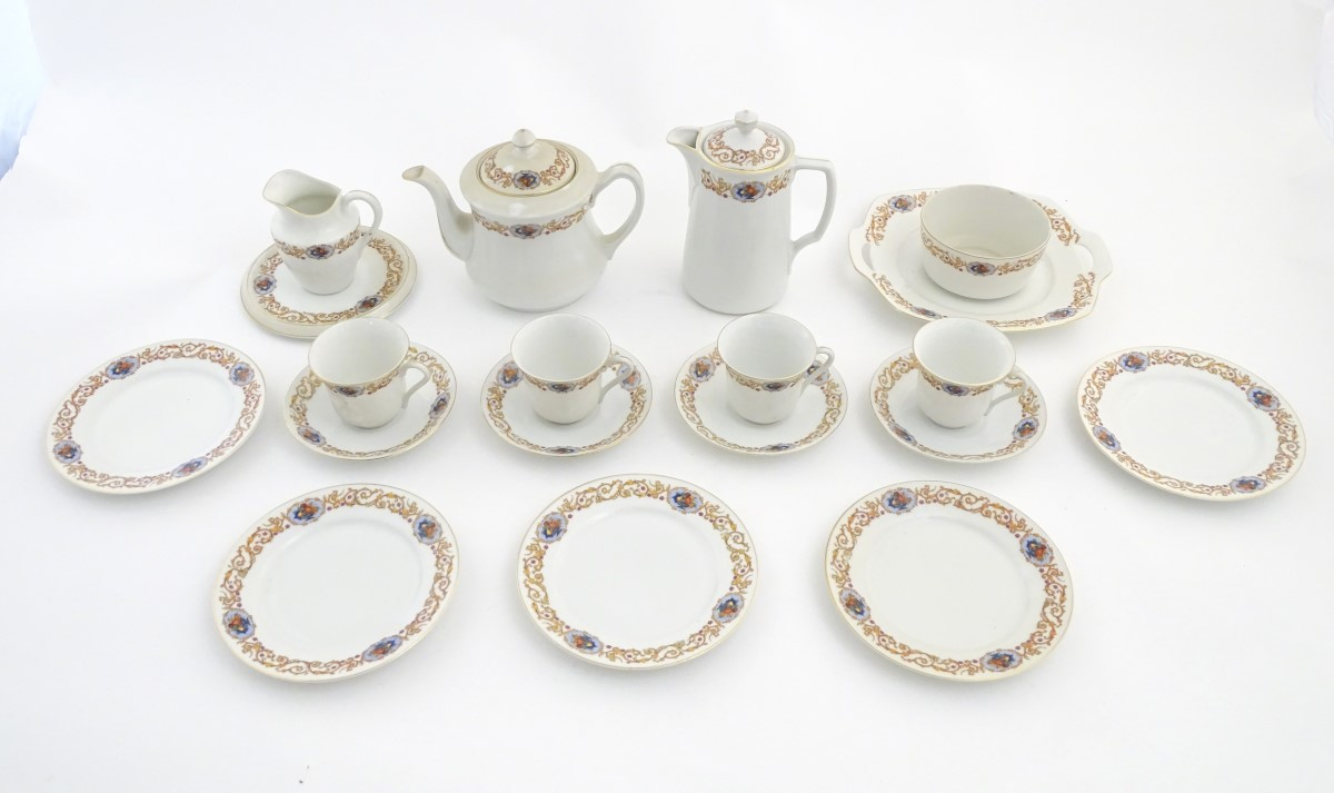 Lot 47 - A Czecho Slovakie tea set with banded decoration to include still lifes in vignettes.