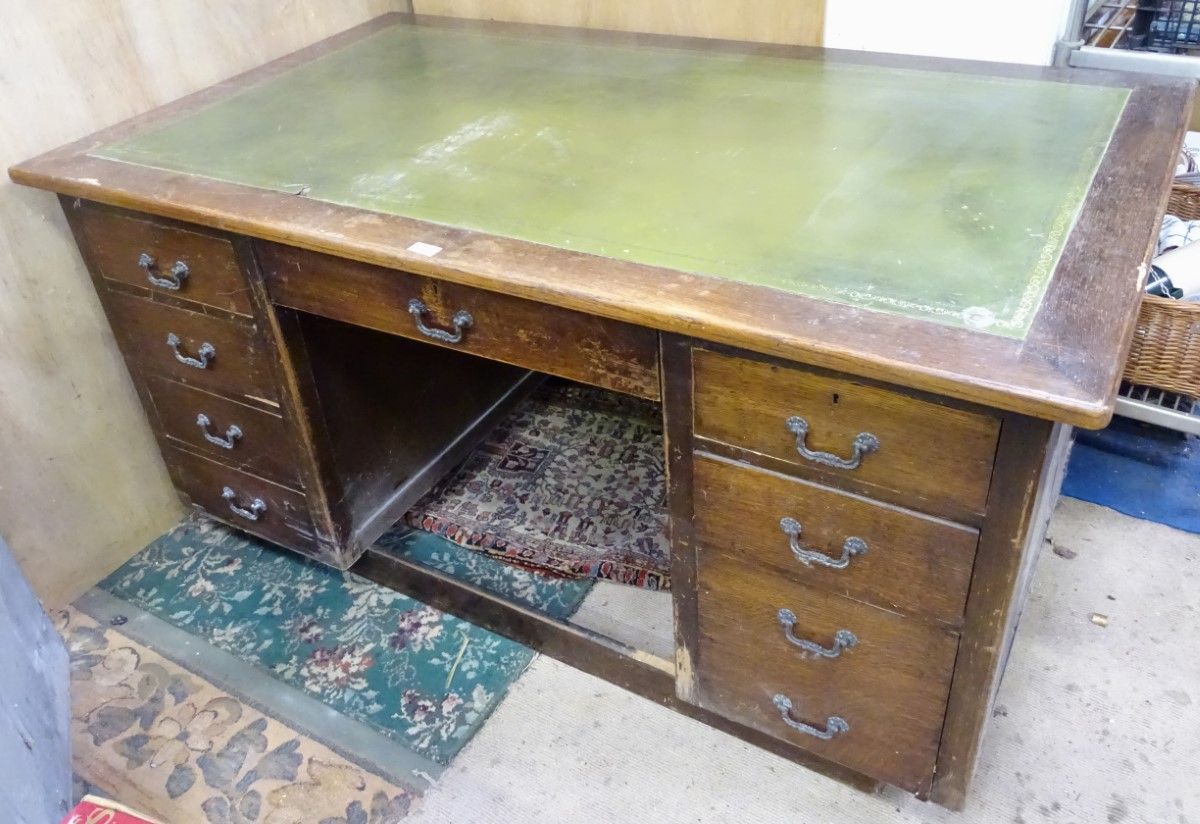 Lot 33 - A 1950s desk with green leather insert to top CONDITION: Please Note - we do not