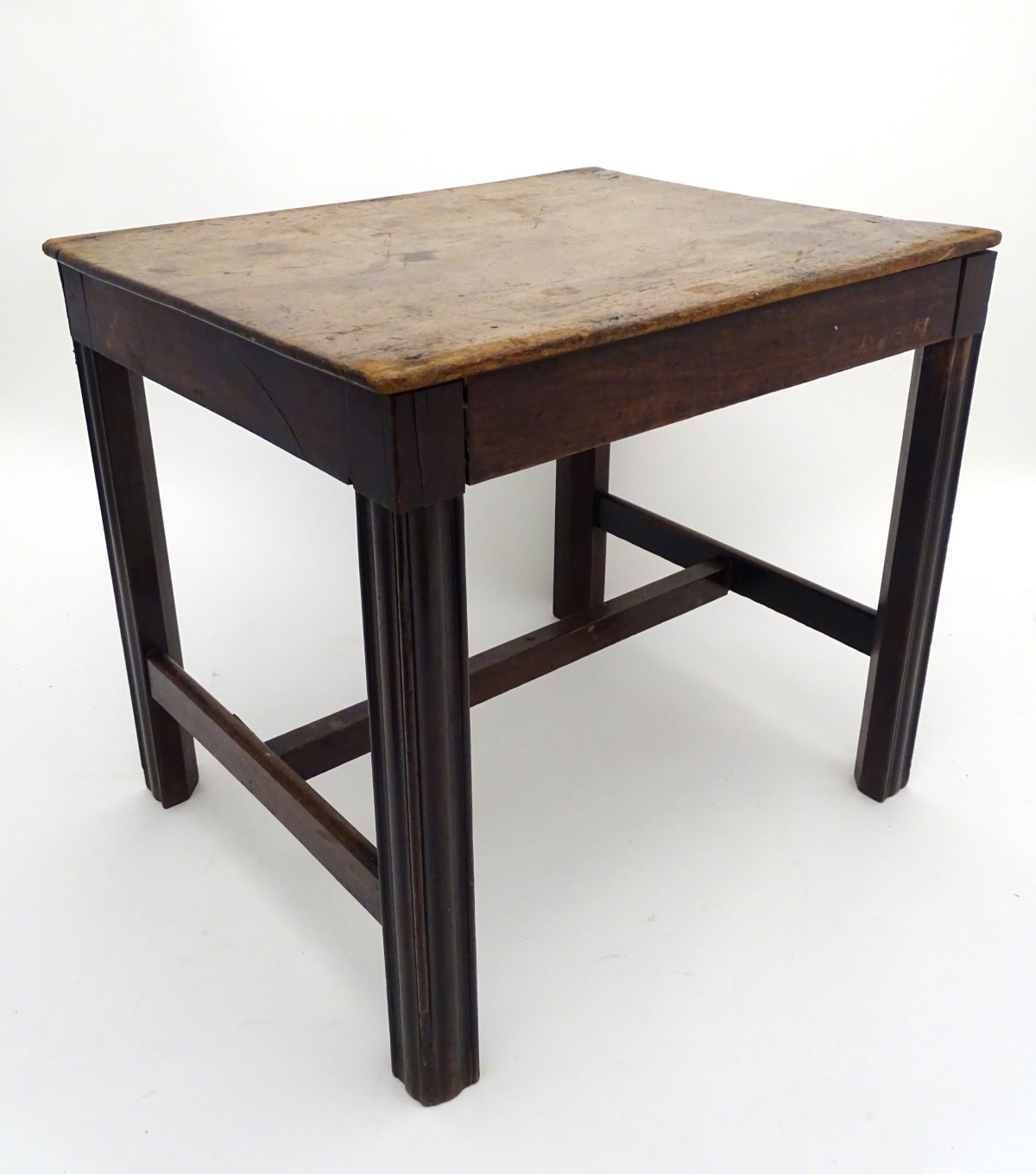 Lot 32 - A late 18thC mahogany low table / stool with moulded legs and a chamfered frame,