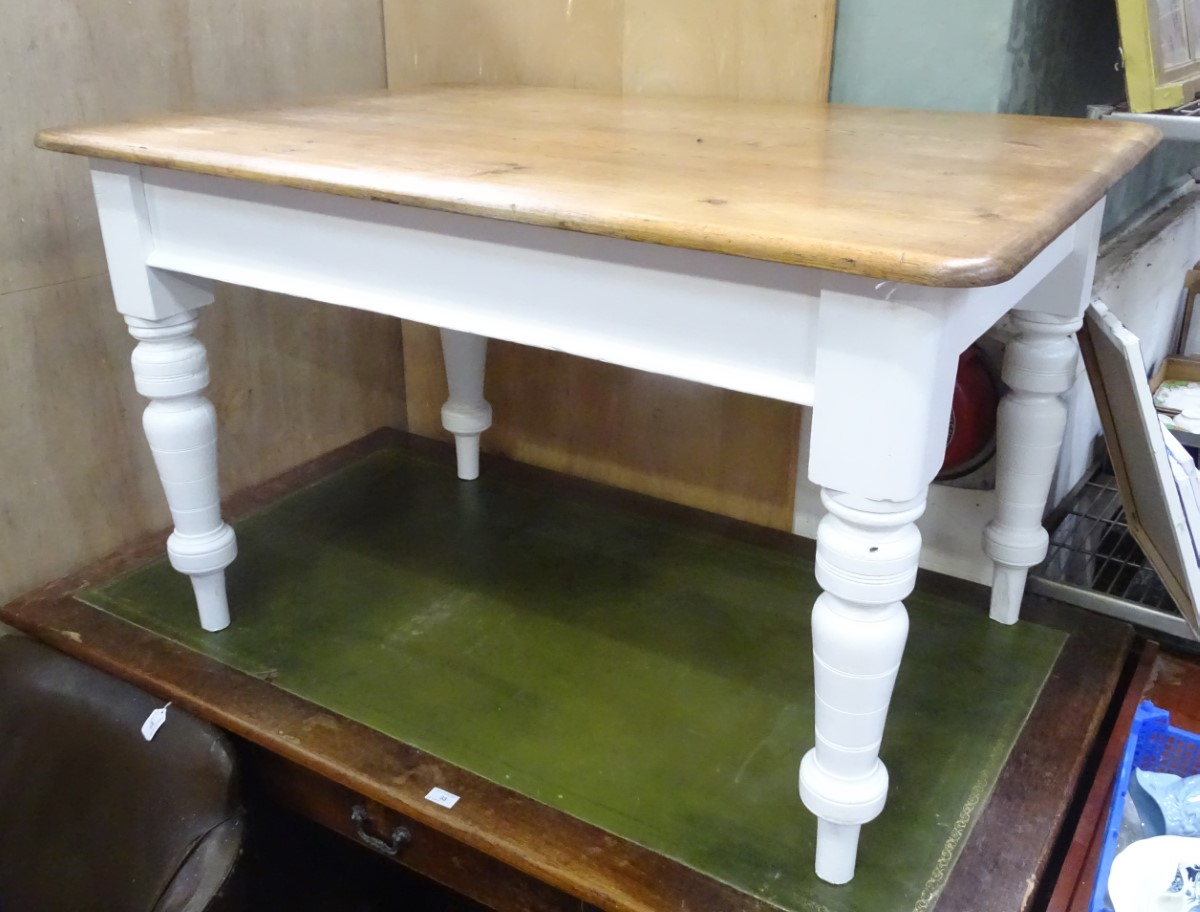 Lot 30 - A pine farmhouse kitchen table with a waxed top and white painted base CONDITION: