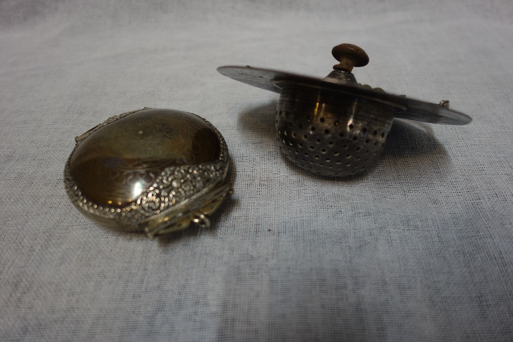 Lot 397 - A BIDRIWARE COPPER AND WHITE METAL TRINKET, and a Indian white metal strainer with turned wooden
