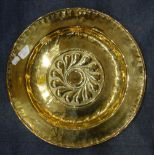 Lot 189 - AN 18TH CENTURY BRASS CHARGER/ ALMS DISH with embossed and engraved decoration, dated '1740'