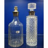 Lot 187 - A CUT GLASS DECANTER with a silver collar and another similar (2)