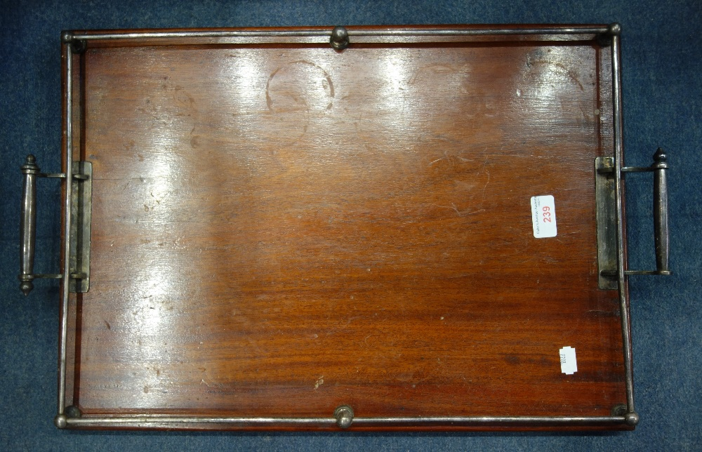 Lot 239 - A MAHOGANY TRAY, with silver plated handles and gallery, 57.5cm wide