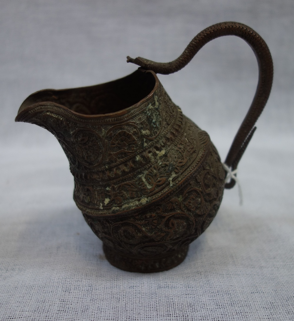 Lot 312 - A BURMESE OR INDIAN CHASED COPPER JUG, with snake handle