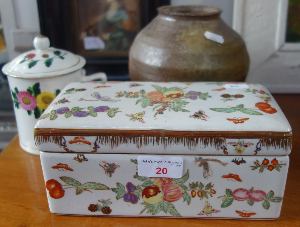 Lot 20 - A RECTANGULAR CHINESE PORCELAIN BOX AND COVER decorated with fruit, birds and flowers, a similar cup