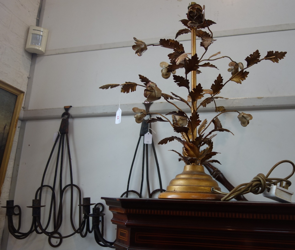 Lot 24 - A DECORATIVE METAL LAMP BASE formed as stems of roses, with a pair of rustic wrought iron three