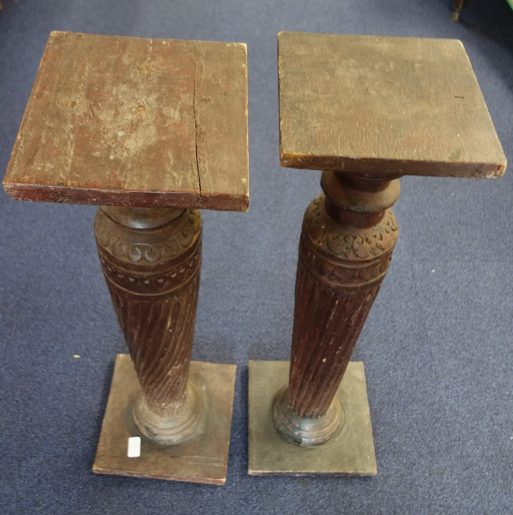 Lot 6 - A PAIR OF INDIAN CARVED HARDWOOD COLUMN STANDS, 82cm high