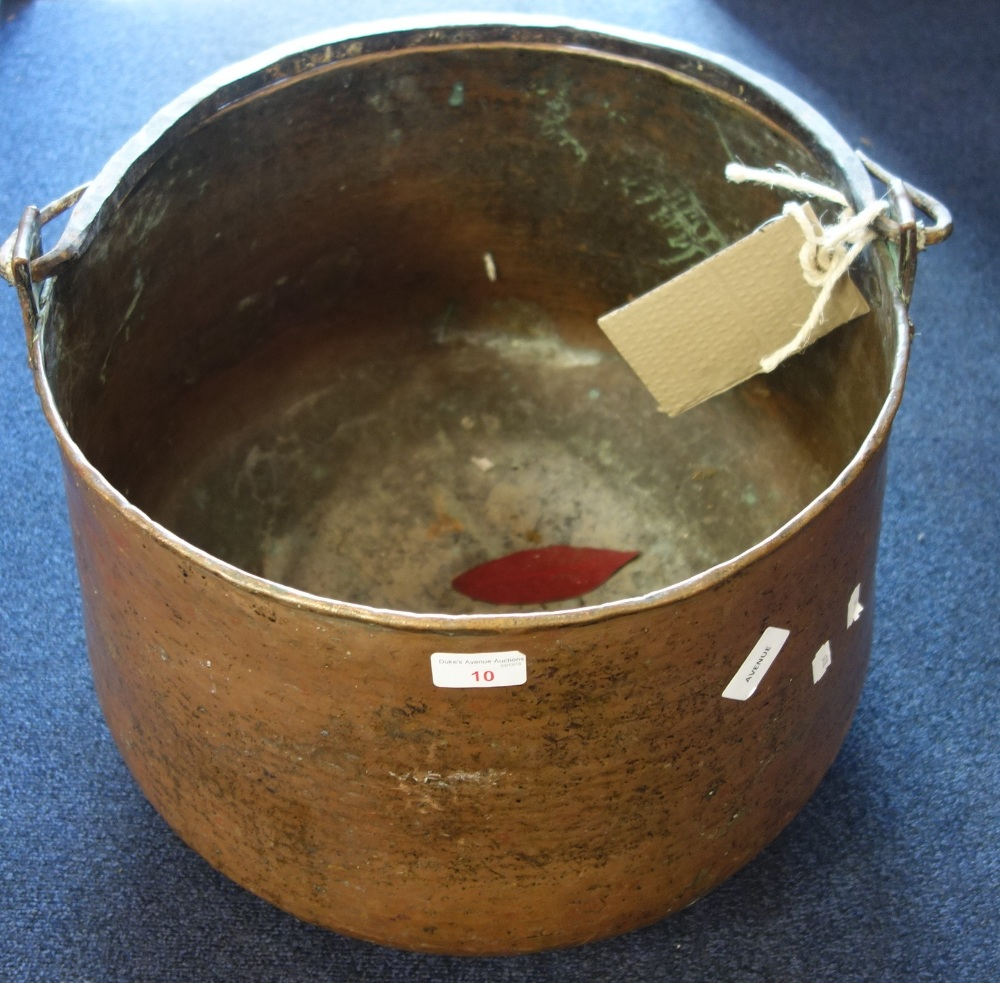 Lot 10 - A LARGE COPPER COOKING VESSEL with iron handle, 42cm diam