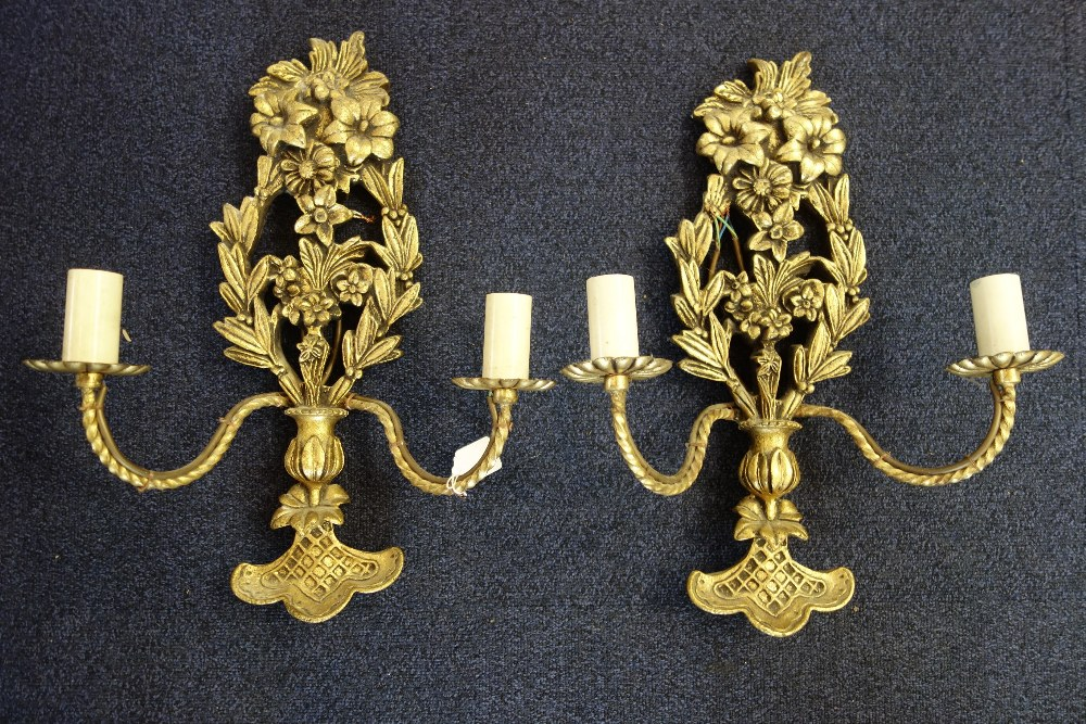 Lot 3 - A PAIR OF GILT TWO BRANCH WALL SCONCES moulded with flowers
