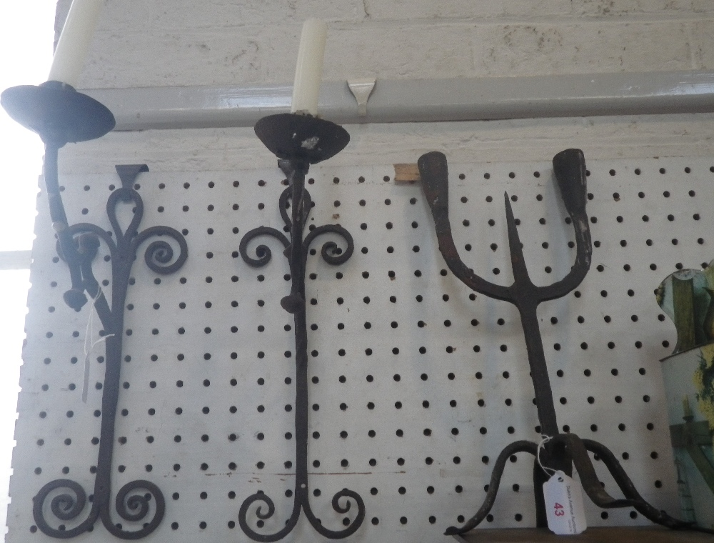 Lot 43 - A PAIR OF RUSTIC GOTHIC STYLE WALL CANDLE SCONCES and a similar two branch candlestick