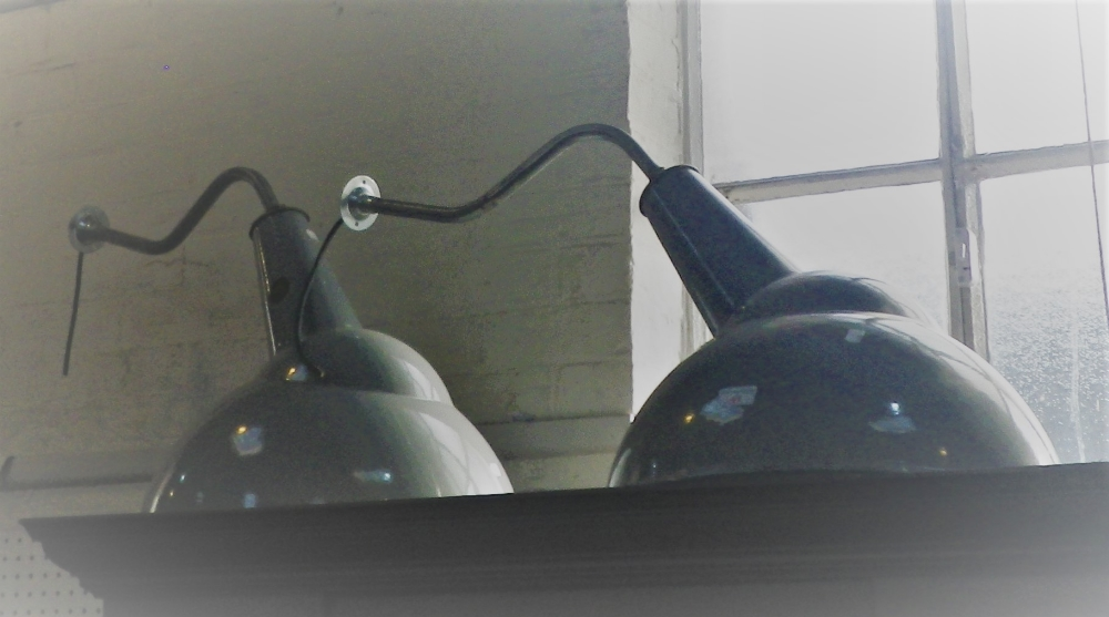 Lot 41 - A PAIR OF LARGE INDUSTRIAL WALL MOUNTED LAMPS with domed shaped grey enamel shades, 48cm diam