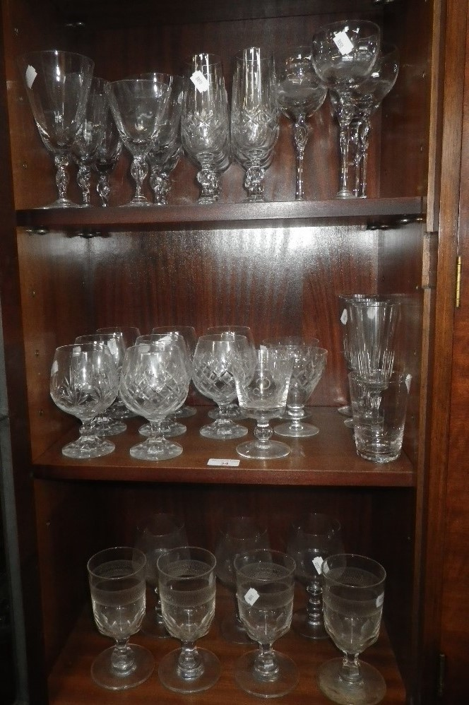 Lot 34 - A COLLECTION OF DRINKING GLASSES, including champagne and brandy glasses