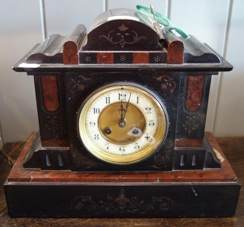 Lot 9 - A VICTORIAN BLACK SLATE AND ROUGE MARBLE MANTEL CLOCK striking on a gong
